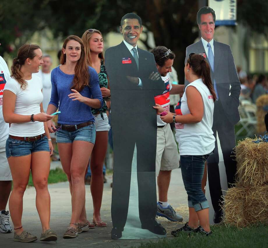 BOCA RATON, FL - OCTOBER 20: People look at card board cutouts of  U.S. President Barack Obama and Republican presidential candidate Mitt Romney at Lynn University as the campus prepares for the final presidential debate October 20, 2012 in Boca Raton, Florida. The debate, which will be held on Monday, October 22, will mark the final meeting between the two candidates before the general election on November 6th.  (Photo by Joe Raedle/Getty Images) Photo: Joe Raedle, Getty Images / 2012 Getty Images