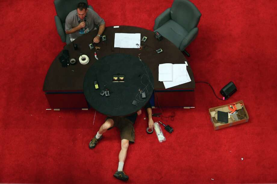 BOCA RATON, FL - OCTOBER 20: Workers prepare the desk for the final presidential debate that will take place at Lynn University on October 23 between U.S. President Barack Obama and Republican presidential candidate Mitt Romney October 20, 2012 in Boca Raton, Florida. The debate will mark the final meeting between the two candidates before the general election on November 6.  (Photo by Joe Raedle/Getty Images) Photo: Joe Raedle, Getty Images / 2012 Getty Images