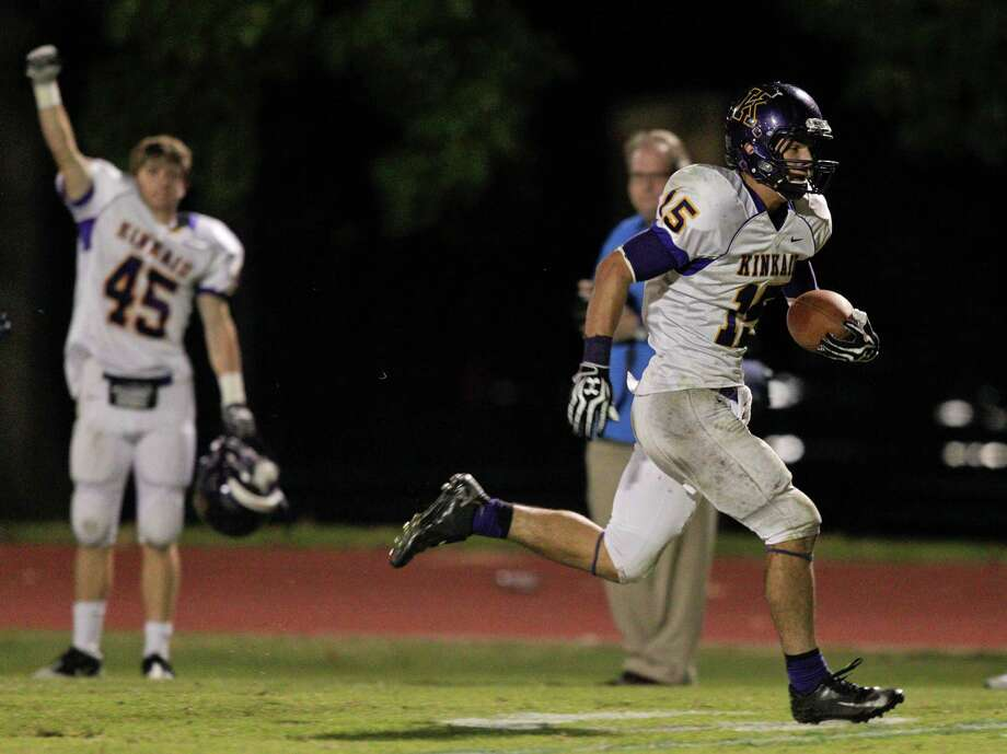 Kinkaid's Macan Wilson #15 breaks a tackle for a 43 yard touchdown run against Episcopal during a SPC football game between Kinkaid and Episcopal Friday, October 19, 2012. Photo: Bob Levey, Photographer / ©2012 Bob Levey