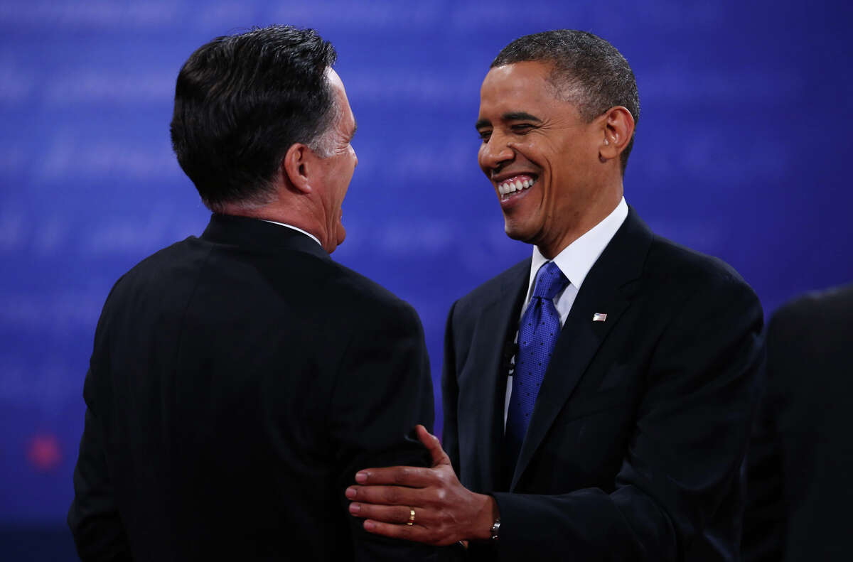 BOCA RATON, FL - OCTOBER 22: U.S. President Barack Obama (R) shakes hands with Republican presidential candidate Mitt Romney after the debate at the Keith C. and Elaine Johnson Wold Performing Arts Center at Lynn University on October 22, 2012 in Boca Raton, Florida. The focus for the final presidential debate before Election Day on November 6 is foreign policy. (Photo by Mark Wilson/Getty Images)