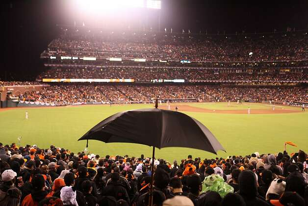 Giants fans respond to scattered rain during Game 7 of the NLCS between the San Francisco Giants and the St. Louis Cardinals at AT&T Park Monday, October 22, 2012 in San Francisco, Calif. Photo: Pete Kiehart, The Chronicle