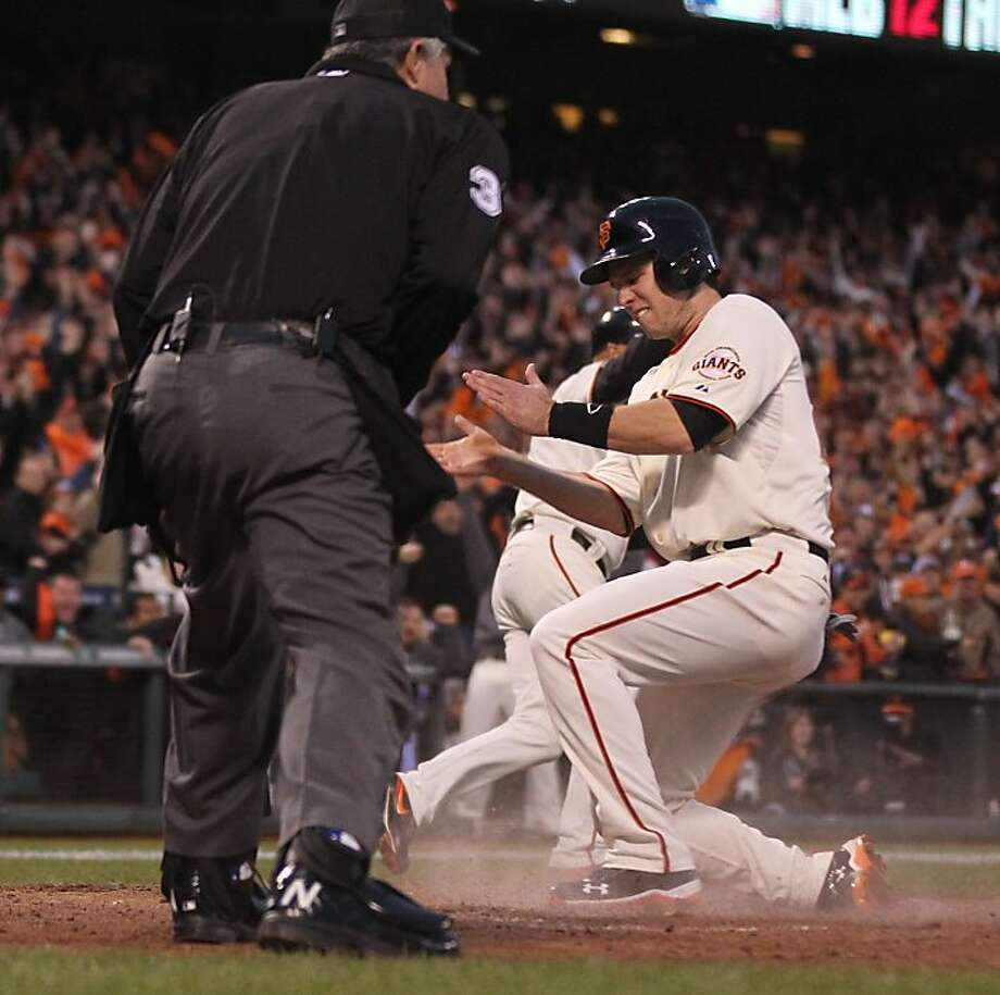 Giants' catcher Buster Posey scores on a Jon Jay error in the 3rd inning during game 7 of the NLCS at AT&T Park on Monday, Oct. 22, 2012 in San Francisco, Calif. Photo: Lance Iversen, The Chronicle