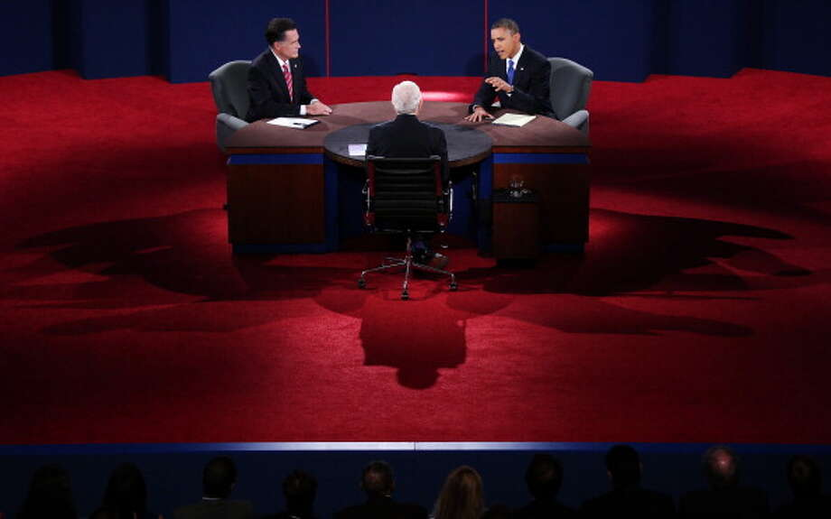 BOCA RATON, FL - OCTOBER 22:  U.S. President Barack Obama (R) debates with Republican presidential candidate Mitt Romney as moderator Bob Schieffer (C) of CBS looks on at the Keith C. and Elaine Johnson Wold Performing Arts Center at Lynn University on October 22, 2012 in Boca Raton, Florida. The focus for the final presidential debate before Election Day on November 6 is foreign policy.  (Photo by Win McNamee/Getty Images) Photo: Win McNamee, Getty Images / 2012 Getty Images