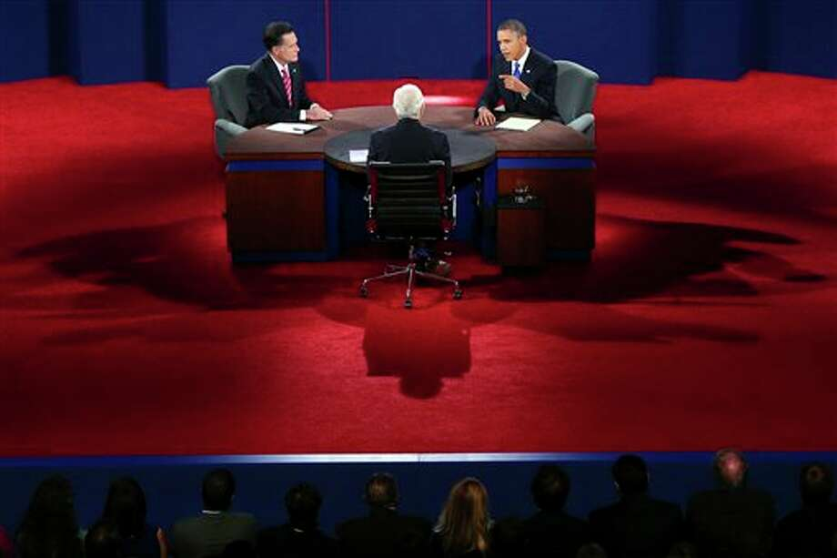 President Barack Obama answers a question as Republican presidential nominee Mitt Romney listens during the third presidential debate at Lynn University, Monday, Oct. 22, 2012, in Boca Raton, Fla. (AP Photo/Pool, Win McNamee) Photo: Win McNamee, AP / Getty Pool