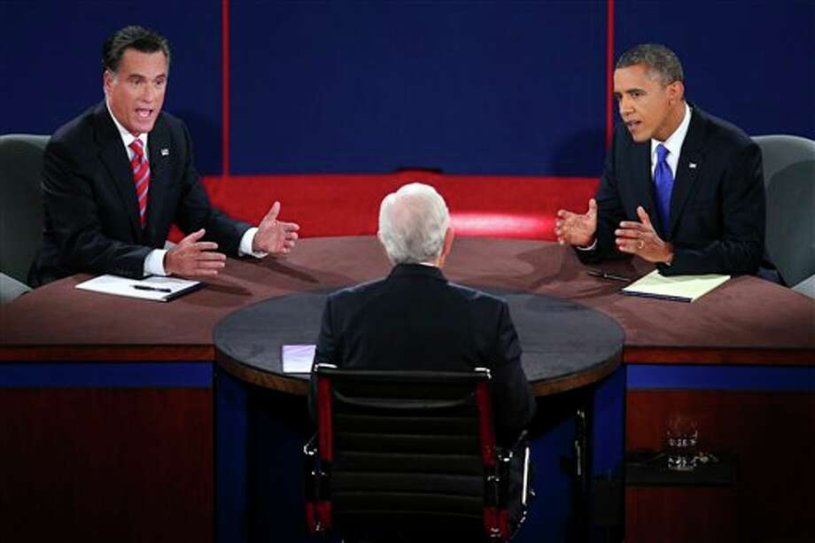 Republican presidential nominee Mitt Romney and President Barack Obama answer a question during the third presidential debate at Lynn University, Monday, Oct. 22, 2012, in Boca Raton, Fla. (AP Photo/Pool-Win McNamee) Photo: Win McNamee, ASSOCIATED PRESS / AP2012