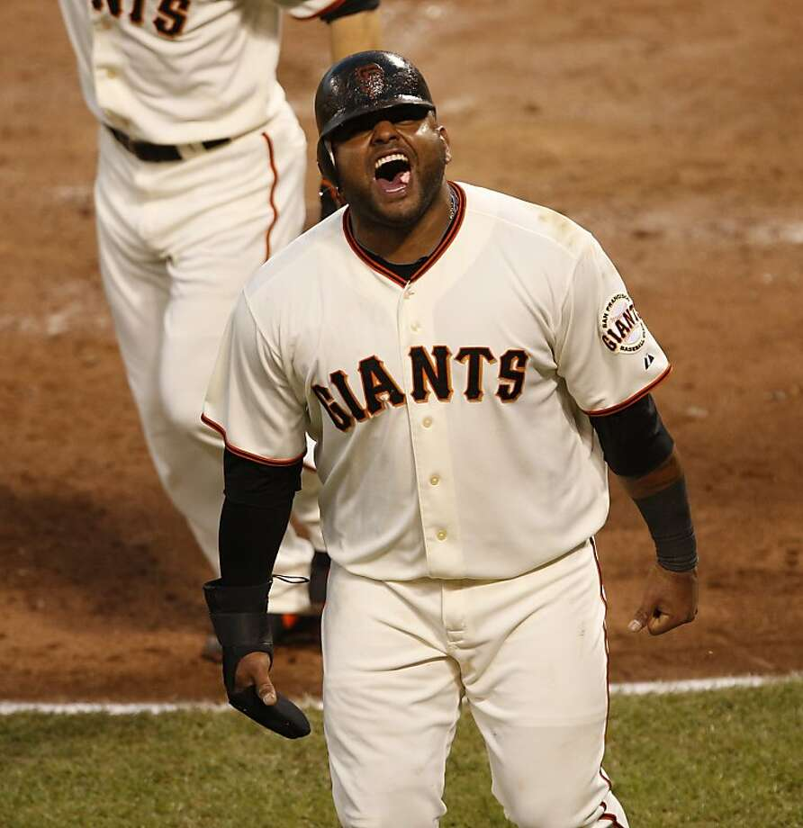 Pablo Sandoval shouts after scoring on Hunter Pence's double during the Giants' five-run third inning. Photo: Beck Diefenbach, The Chronicle