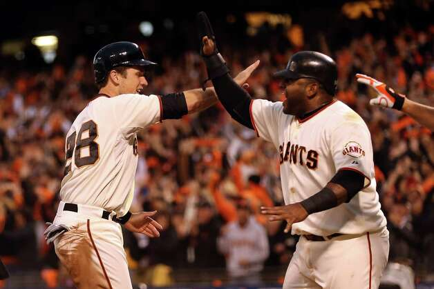SAN FRANCISCO, CA - OCTOBER 22:  Buster Posey #28 and Pablo Sandoval #48 of the San Francisco Giants celebrate after scoring in the third inning on a three-run double by Hunter Pence #8 against the St. Louis Cardinals in Game Seven of the National League Championship Series at AT&T Park on October 22, 2012 in San Francisco, California.  (Photo by Ezra Shaw/Getty Images) Photo: Ezra Shaw