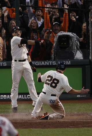 Giants' catcher Buster Posey scores in the 3rd on a Jon Jay error during the NLCS game 7 at AT&T Park in San Francisco, Calif., on Monday, Oct. 22, 2012. Photo: Carlos Avila Gonzalez, The Chronicle