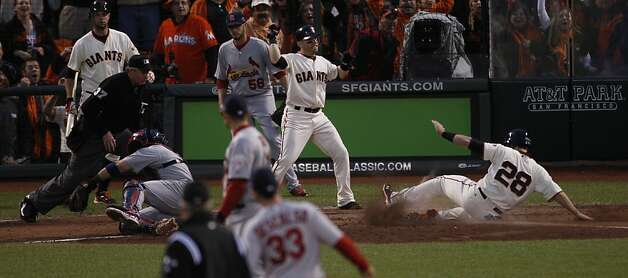 Giants catcher Buster Posey (28) scores on a Jon Jay error in the five-run third inning. Photo: Carlos Avila Gonzalez, The Chronicle