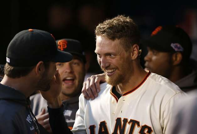 Giants' right fielder Hunter Pence smiles in the dugout after scoring in the 3rd inning during game 7 of the NLCS at AT&T Park on Monday, Oct. 22, 2012 in San Francisco, Calif. Photo: Michael Macor, The Chronicle