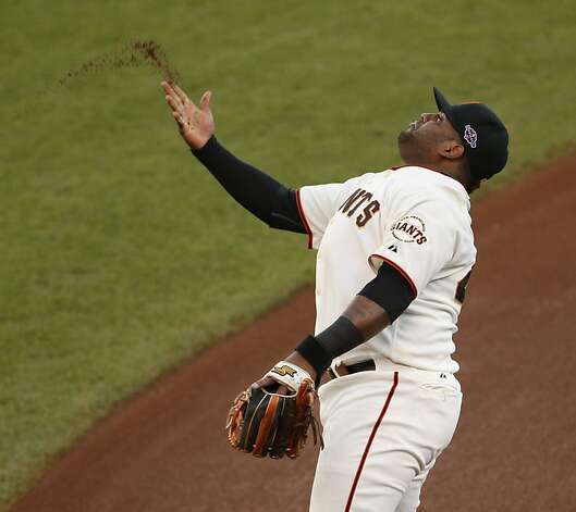 Giants' third baseman Pablo Sandoval tosses some infield dirt prior to game 7 of the NLCS at AT&T Park on Monday, Oct. 22, 2012 in San Francisco, Calif. Photo: Beck Diefenbach, The Chronicle