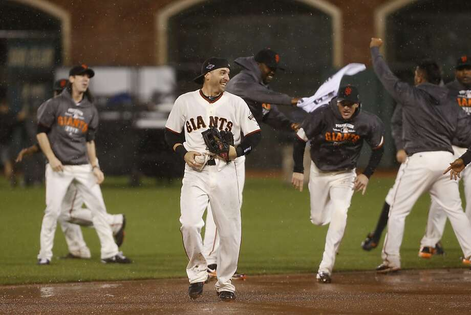 The Giants celebrate their 9-0 victory over the St. Louis Cardinals to advance to the World Series game 7 of the NLCS at AT&T Park on Monday, Oct. 22, 2012 in San Francisco, Calif. Photo: Michael Macor, The Chronicle