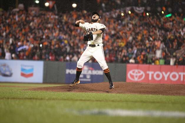 Giants' pitcher Sergio Romo celebrates the Giants' 9-0 victory over the St. Louis Cardinals to advance to the World Series during game 7 of the NLCS at AT&T Park on Monday, Oct. 22, 2012 in San Francisco, Calif. Photo: Lance Iversen, The Chronicle