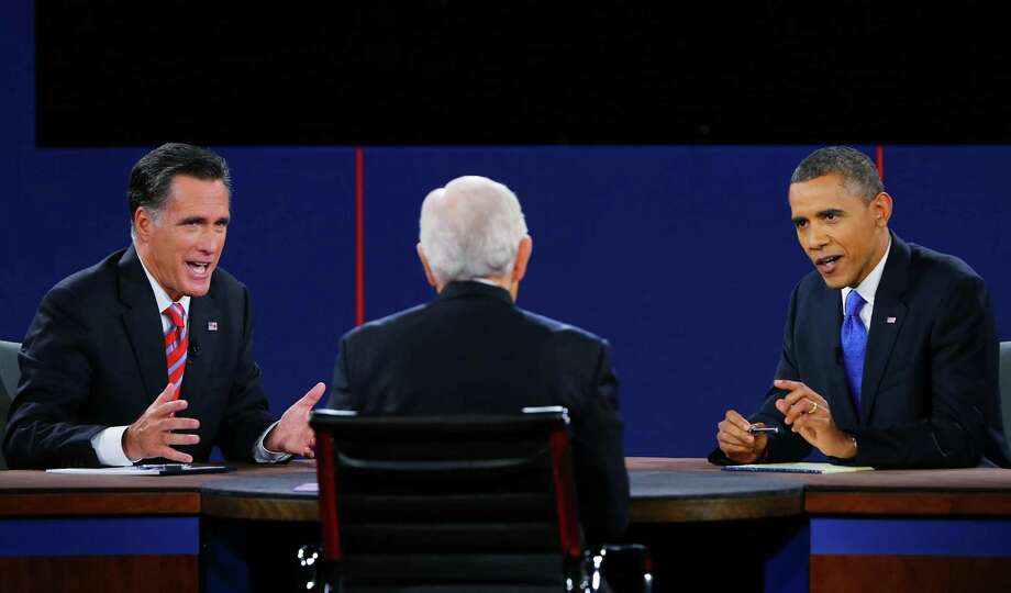 Mitt Romney and President Barack Obama make their points to CBS moderator Bob Schieffer in their final debate, which focused on foreign policy. Photo: Joe Raedle / 2012 Getty Images