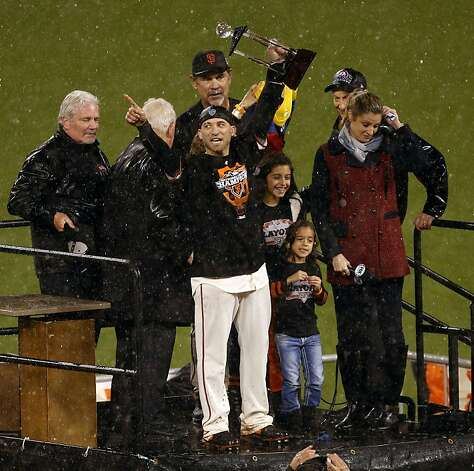 San Francisco Giants second baseman Marco Scutaro hoists the National League Championship Series Most Valuable Player trophy after defeating the St. Louis Cardinals on Monday, October 22, 2012 in San Francisco, Calif. Photo: Beck Diefenbach, Special To The Chronicle