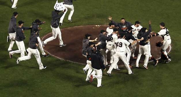The Giants mob pitcher Sergio Romo after the last out of the game. The San Francisco Giants defeated the St. Louis Cardinals in Game 7 of the National League Championship Series 9-0 at AT&T Park on Monday, October 22, 2012, in San Francisco, Calif., The Giants defeated the Cardinals and will advance to the World Series Photo: Carlos Avila Gonzalez, The Chronicle