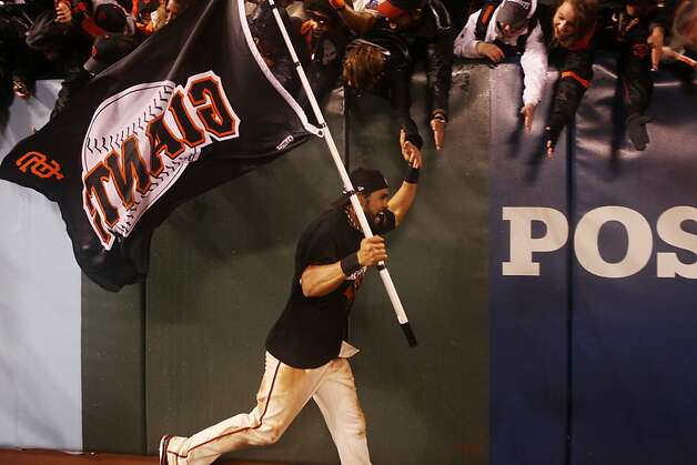 Angel Pagan high fives fans during a run around the bases after the San Francisco Giants' victory in Game 7 of the NLCS  over the St. Louis Cardinals at AT&T Park Monday, October 22, 2012 in San Francisco, Calif. Photo: Pete Kiehart, The Chronicle