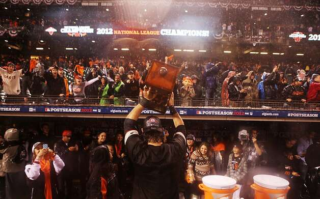 Brandon Crawford displays the NLCS trophy to fans after the San Francisco Giants' victory in Game 7 of the NLCS  over the St. Louis Cardinals at AT&T Park Monday, October 22, 2012 in San Francisco, Calif. Photo: Pete Kiehart, The Chronicle
