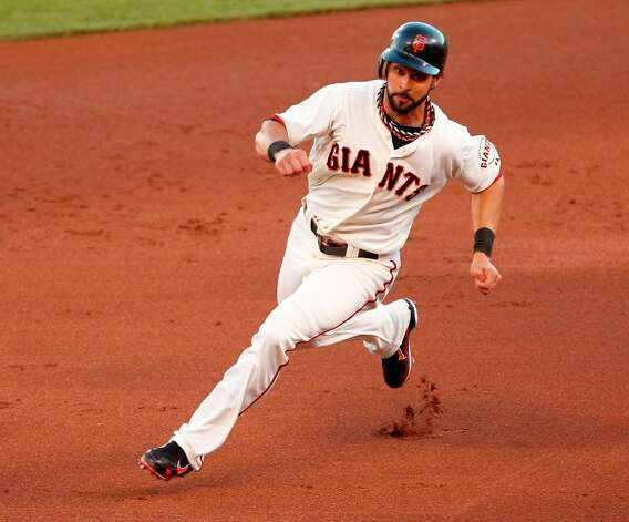 Giants' center fielder Angel Pagan rounds second base on his way to 3rd base in the 1st inning during game 7 of the NLCS at AT&T Park on Monday, Oct. 22, 2012 in San Francisco, Calif. Photo: Beck Diefenbach, The Chronicle / ONLINE_YES