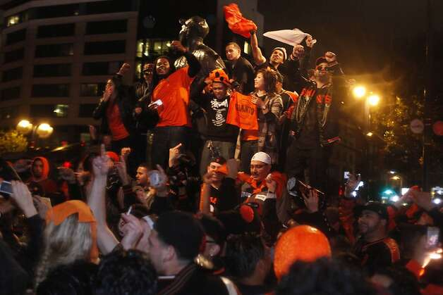 San Francisco Giants fans celebrate the San Francisco Giants win in Game 7 of the NLCS against the St. Louis Cardinals outside of AT&T Park on Monday, October 22, 2012 in San Francisco, Calif. Final Score:  Giants: 9 - Cardinals: 0. Photo: Lea Suzuki, The Chronicle