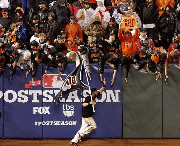 Angel Pagan runs with a Giants flag past adoring fans in the outfield. The San Francisco Giants defeated the St. Louis Cardinals 9-0 to win the National League pennant Monday October 22, 2012 at AT&T park. Photo: Brant Ward, The Chronicle