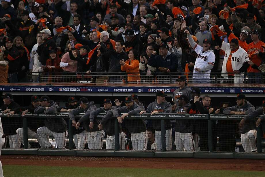 The fans in the stands behind the Giants dugout provided an electric atmosphere in Game 7 of the National League Championship Series. Photo: Carlos Avila Gonzalez, The Chronicle
