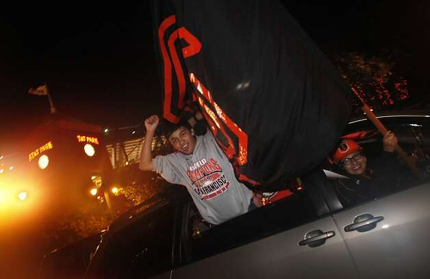 San Francisco Giants fans celebrate the San Francisco Giants win in Game 7 of the NLCS against the St. Louis Cardinals from their cars as they move down King Street on Monday, October 22, 2012 in San Francisco, Calif. Final Score:  Giants: 9 - Cardinals: 0. Photo: Lea Suzuki, The Chronicle