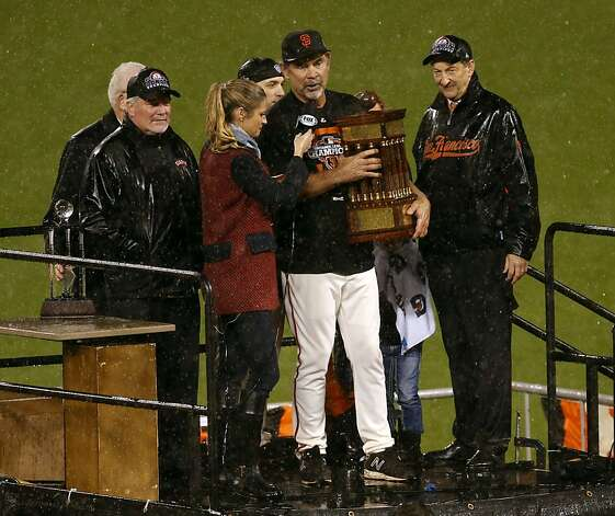 San Francisco Giants manager Bruce Bochy clutches the National League Championship trophy after defeating the St. Louis Cardinals on Monday, October 22, 2012 in San Francisco, Calif. Photo: Beck Diefenbach, Special To The Chronicle