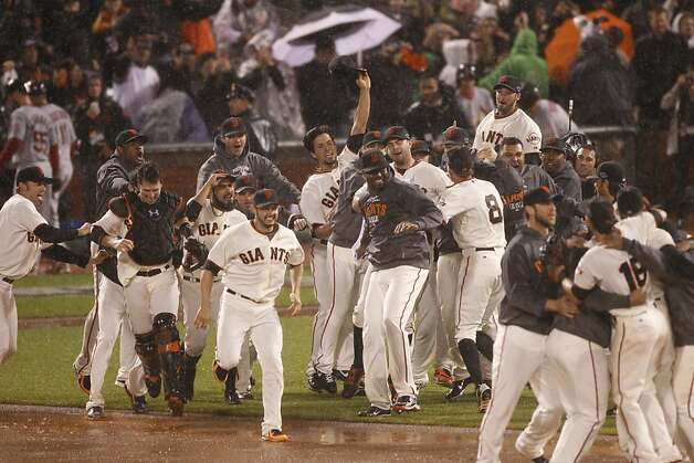 The Giants celebrate the Giants 9-0 win over the St. Louis Cardinals to advance to the World Series  during the NLCS game 7 at AT&T Park in San Francisco, Calif., on Monday, Oct. 22, 2012. Photo: Carlos Avila Gonzalez, The Chronicle