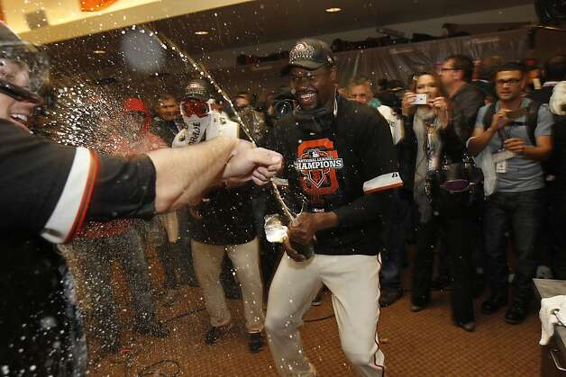 San Francisco  pitcher Guillermo Mota  sprays champagne over a teammate as they celebrate their victory over the St. Louis Cardinals 9-0 to win the NLCS Championship game at AT&T Park Monday, Oct. 22, 2012 in San Francisco, Calif. Photo: Lance Iversen, The Chronicle