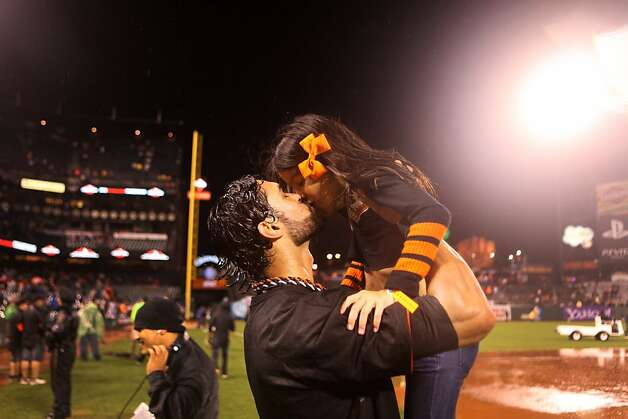 Angel Pagan kisses one of his daughters after the San Francisco Giants' victory in Game 7 of the NLCS  over the St. Louis Cardinals at AT&T Park Monday, October 22, 2012 in San Francisco, Calif. Photo: Pete Kiehart, The Chronicle
