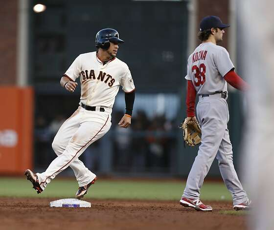 Giants' left fielder Gregor Blanco advances to 2nd base in the 2nd inning during game 7 of the NLCS at AT&T Park on Monday, Oct. 22, 2012 in San Francisco, Calif. Photo: Michael Macor, The Chronicle