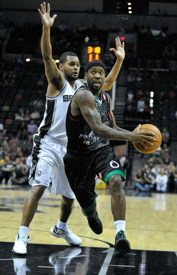 Montepaschi Siena guard Bobby Brown drives past San Antonio Spurs guard Patty Mills during the second half of an NBA preseason basketball game on Saturday, Oct. 6, 2012, in San Antonio. The Spurs defeated Siena 106-77. (AP Photo/Bahram Mark Sobhani)
