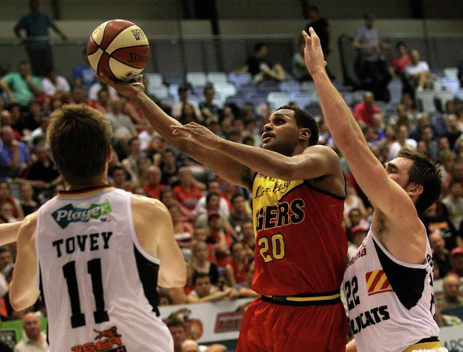 Patty Mills of the Tigers lays up during the round seven NBL match between the Melbourne Tigers and the Perth Wildcats at the State Netball Hockey Centre on November 18, 2011 in Melbourne, Australia.  (Photo by Hamish Blair/Getty Images) Photo: Hamish Blair, Getty Images / 2011 Getty Images