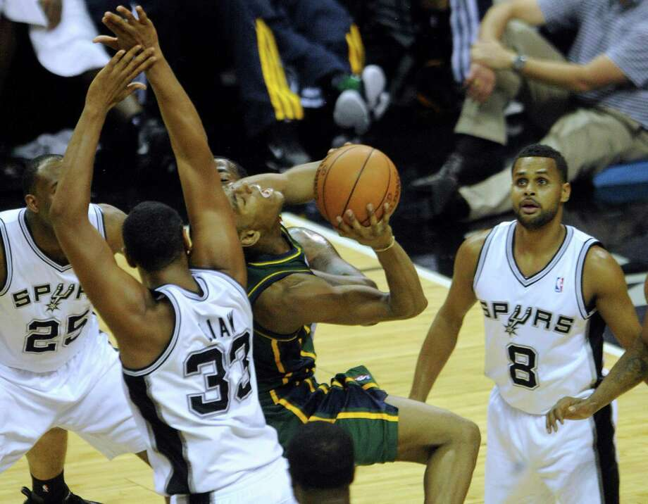Alec Burks (10) of the Utah Jazz shoots a layup as he is defended by Boris Diaw (33), James Anderson (25), Patty Mills (8) and Stephen Jackson (3) of the Spurs during second-half NBA playoffs action at the AT&T Center on Wednesday, May 2, 2012.  Billy Calzada / San Antonio Express-News Photo: BILLY CALZADA, San Antonio Express-News / SAN ANTONIO EXPRESS-NEWS