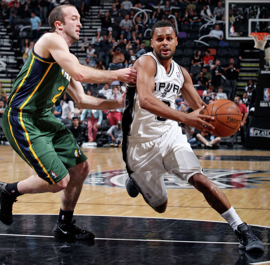 Spurs guard Patty Mills drives around Utah's Blake Ahern during second half action of Game 2 of the Western Conference first round Wednesday May 2, 2012 at the AT&T Center. The Spurs won 114-83. Photo: EDWARD A. ORNELAS, SAN ANTONIO EXPRESS-NEWS / © SAN ANTONIO EXPRESS-NEWS (NFS)
