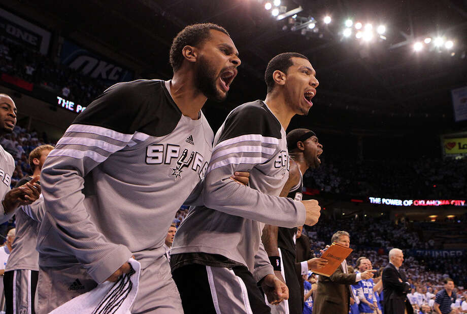 San Antonio Spurs' Patty Mills, left, and San Antonio Spurs' Danny Green (4) yell from the bench during the second half of game four of the NBA Western Conference Finals in Oklahoma City, Okla. on Saturday, June 2, 2012. Photo: Kin Man Hui, San Antonio Express-News / © 2012 San Antonio Express-News