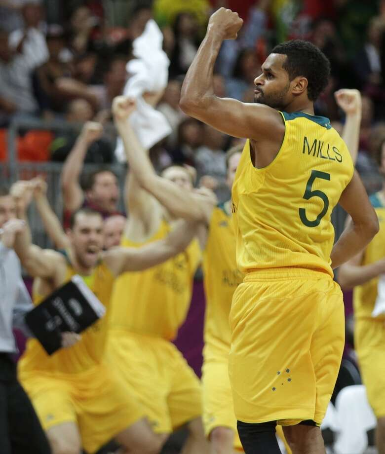 Australia's Patrick Mills pumps his fist after hitting the game-winning 3-point shot to pull ahead of Russia with time expiring during a men's basketball game at the 2012 Summer Olympics, Monday, Aug. 6, 2012, in London.(AP Photo/Charles Krupa)