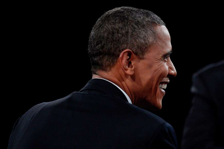 BOCA RATON, FL - OCTOBER 22:  U.S. President Barack Obama smiles during the debate with Republican presidential candidate Mitt Romney at the Keith C. and Elaine Johnson Wold Performing Arts Center at Lynn University on October 22, 2012 in Boca Raton, Florida. The focus for the final presidential debate before Election Day on November 6 is foreign policy.  (Photo by Michael Reynolds-Pool/Getty Images) Photo: Pool, Getty Images / 2012 Getty Images