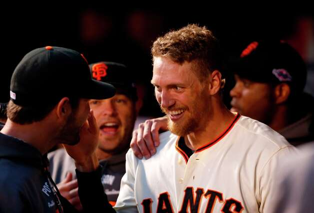 Giants' right fielder Hunter Pence smiles in the dugout after scoring in the 3rd inning during game 7 of the NLCS at AT&T Park on Monday, Oct. 22, 2012 in San Francisco, Calif. Photo: Michael Macor, The Chronicle / ONLINE_YES