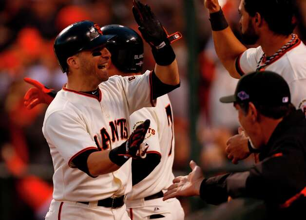 Giants' second baseman Marco Scutaro gets a high five from Angel Pagan after scoring in the 3rd inning during game 7 of the NLCS at AT&T Park on Monday, Oct. 22, 2012 in San Francisco, Calif. Photo: Michael Macor, The Chronicle / ONLINE_YES