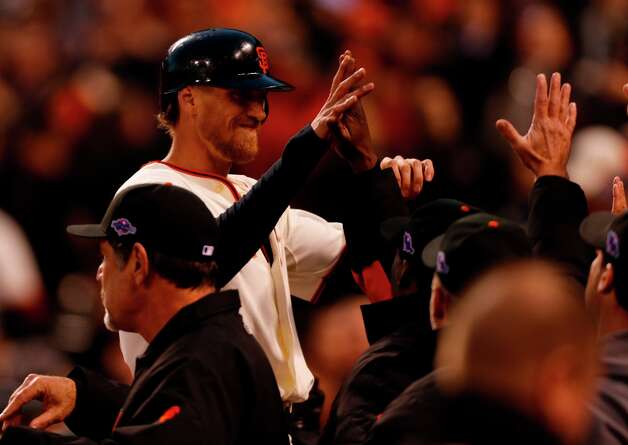 Giants' right fielder Hunter Pence returns to the dugout after scoring in the 3rd inning during game 7 of the NLCS at AT&T Park on Monday, Oct. 22, 2012 in San Francisco, Calif. Photo: Michael Macor, The Chronicle / ONLINE_YES
