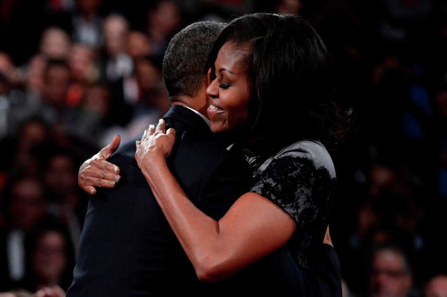 BOCA RATON, FL - OCTOBER 22:  U.S. President Barack Obama hugs first lady Michelle Obama after the debate at the Keith C. and Elaine Johnson Wold Performing Arts Center at Lynn University on October 22, 2012 in Boca Raton, Florida. The focus for the final presidential debate before Election Day on November 6 is foreign policy.  (Photo by Michael Reynolds-Pool/Getty Images) Photo: Pool, Getty Images / 2012 Getty Images