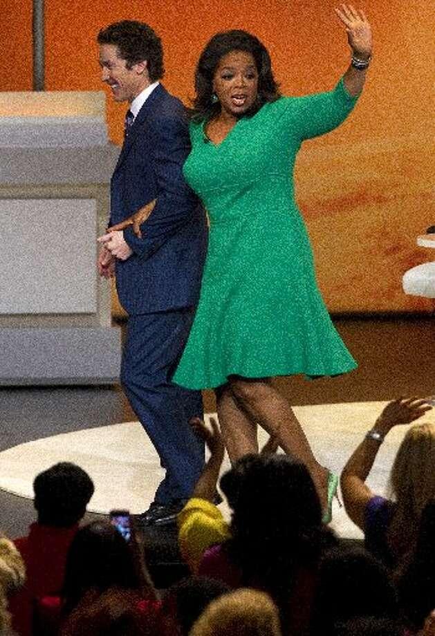 Oprah Winfrey in Houston with Joel Osteen.