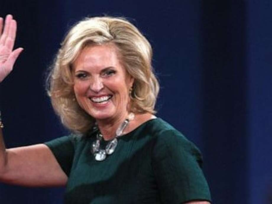 Not a dress, but Ann Romney wore green - a silk green top and skirt - at the Monday's Presidential debate.