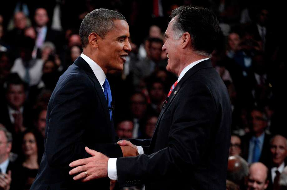 BOCA RATON, FL - OCTOBER 22:  U.S. President Barack Obama (R) shakes hands with Republican presidential candidate Mitt Romney after the debate at the Keith C. and Elaine Johnson Wold Performing Arts Center at Lynn University on October 22, 2012 in Boca Raton, Florida. The focus for the final presidential debate before Election Day on November 6 is foreign policy.  (Photo by Michael Reynolds-Pool/Getty Images) Photo: Pool, Getty Images / 2012 Getty Images
