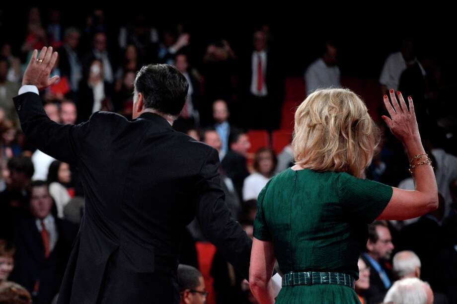 BOCA RATON, FL - OCTOBER 22:  Republican presidential candidate Mitt Romney with wife, Ann Romney wave on stage after the debate at the Keith C. and Elaine Johnson Wold Performing Arts Center at Lynn University on October 22, 2012 in Boca Raton, Florida. The focus for the final presidential debate before Election Day on November 6 is foreign policy.  (Photo by Michael Reynolds-Pool/Getty Images) Photo: Pool, Getty Images / 2012 Getty Images