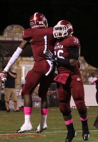 Demarcus Collins (1) and Terrance Cuney celebrate a Jasper touchdown. Photo: Jason Dunn