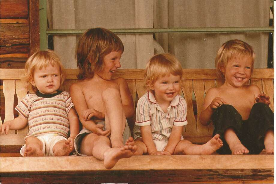 Back in 1983, the Kefauvers lived in the small town of Rice, Wash., in the rural northeast corner of the state. Sitting on a swing in front of the log cabin where they spent their early years are Laura (from left), 2, Johnny, 5, Megan (Laura s twin), 2, and Shawn, 3. Photo: Courtesy Photo