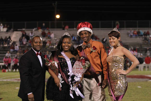 Jasper homecoming court. From left, Victor Williams, Robin Renfro, Josh Thomas and last year's queen Jamie Cowan. Photo: Jason Dunn
